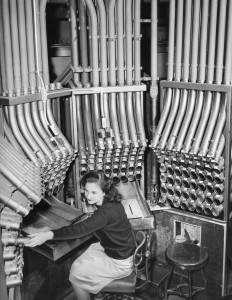 Helen Sarros works new pneumatic tube system to take cash at the Marshall Field s store. Queen of Mighty Basement Consoie November 26, 1947) Sun-Times files